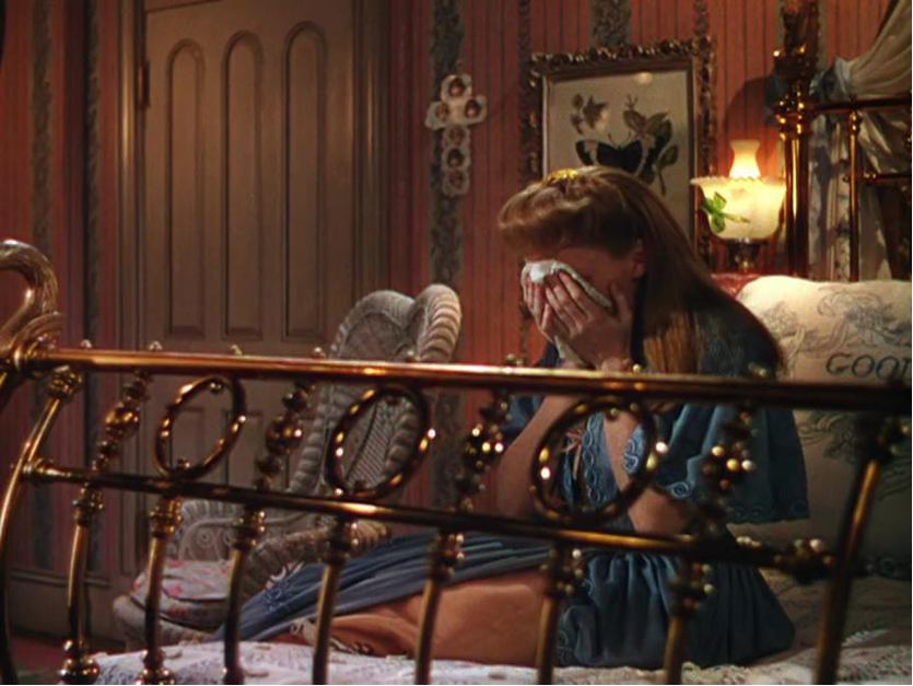 Figure 6: In a moment of crisis the heroine is depicted behind the bars of her brass bed in MEET ME IN ST. LOUIS (Vincente Minnelli,  USA 1944).
